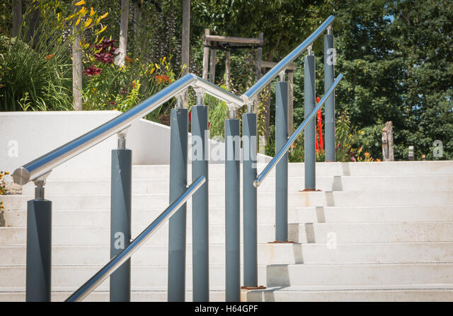 Modern Outside Stairs With Metal Ramp   Stock Image