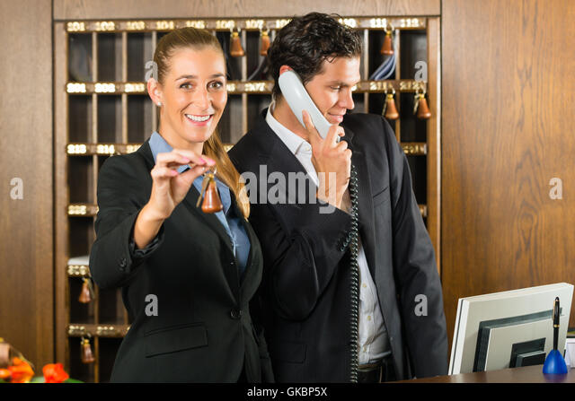 Hotel Receptionist Phone Stock Photos & Hotel Receptionist ...