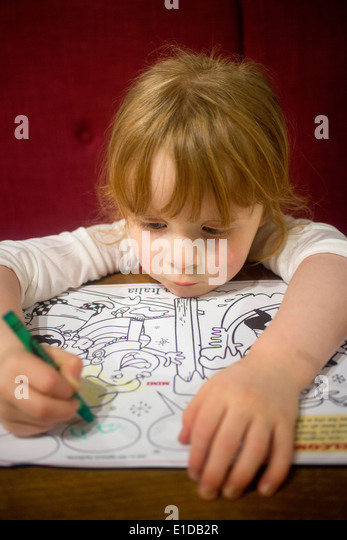 Four Year 4 Old Girl Drawing And Coloring In With Crayons