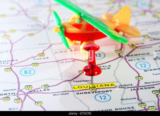 Close Up Of Louisiana Usa Map With Red Pin And Airplane Toy Travel Concept