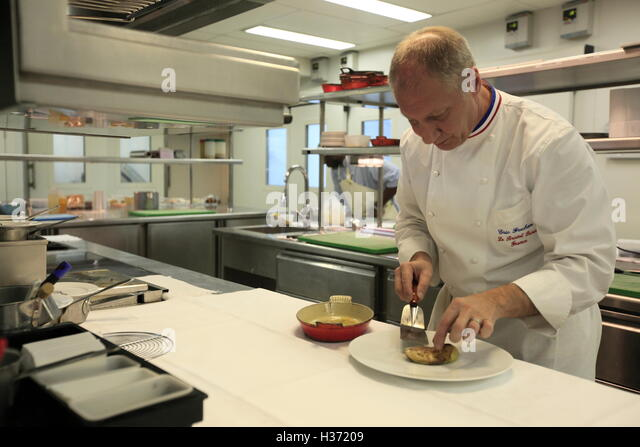 chef eric frenchon in the kitchen of 3 michelin stared gastronomic
