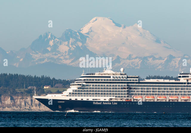 Cruise ship, cruise liner sails on Puget Sound past Mount Baker. - Stock Image