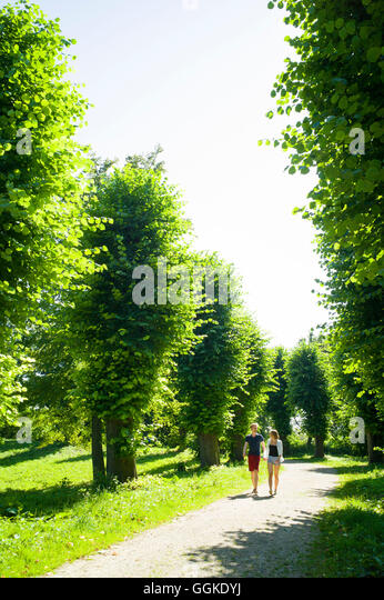strolling park summer couple stock photos strolling park. Black Bedroom Furniture Sets. Home Design Ideas