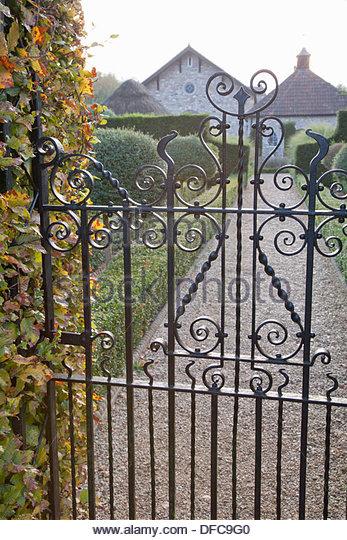 Decorative Metal Gate Through To Formal Garden Garden: Lady Farm, Somerset    Stock Image