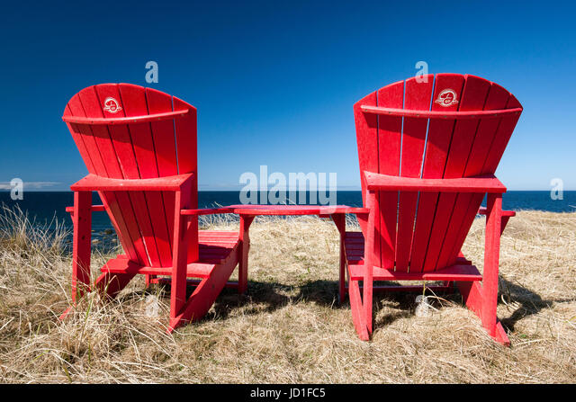 Red Adirondack Chairs At Green Point, Gros Morne National Park,  Newfoundland, Canada