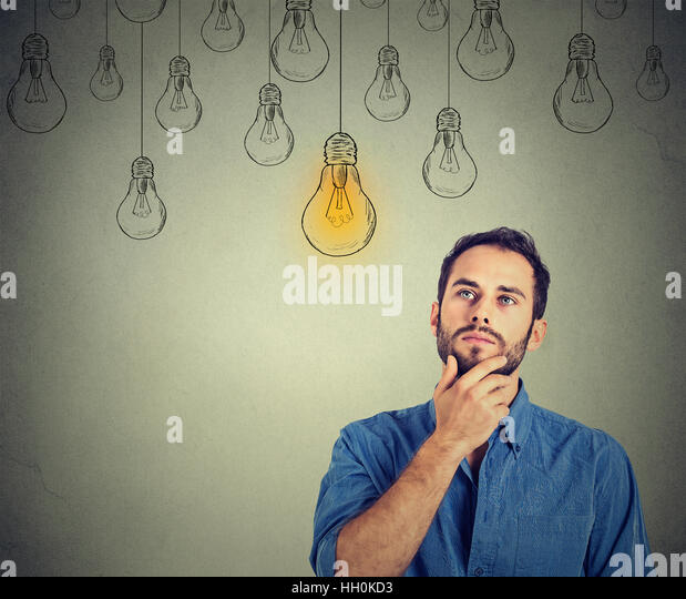 Portrait Thinking Handsome Man Looking Up With Idea Light Bulb Above Head Isolated On Gray Wall