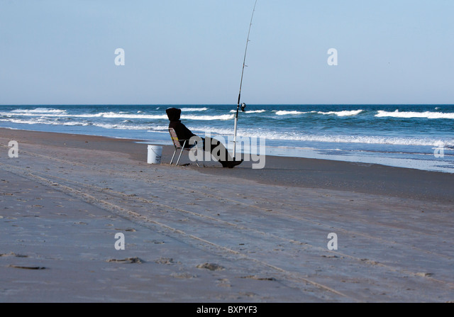 Fishing pole and chair stock photos fishing pole and for Florida surf fishing