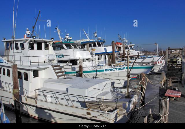 Fishing boat fleet stock photos fishing boat fleet stock for Fishing boats long island
