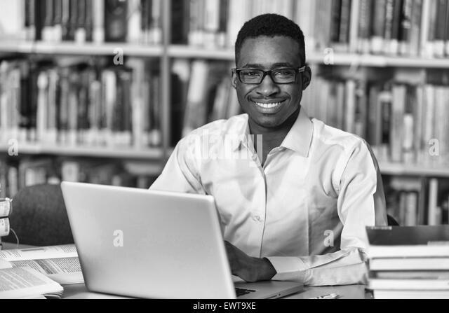 Black Student Sitting At Desk
