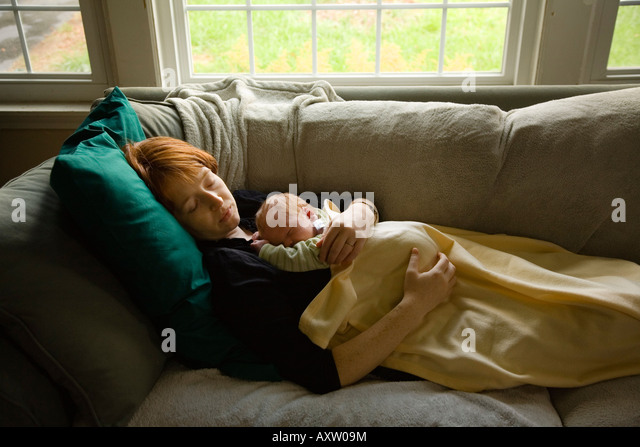 Mother And Her Newborn Baby Nap At Their Home In Willimantic CT USA