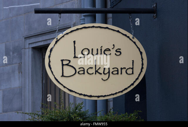 Pub sign in Kilkenny, Ireland  Louies Backyard is part of the Left