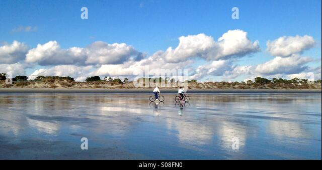bicyclists-cruise-along-the-sand-at-low-