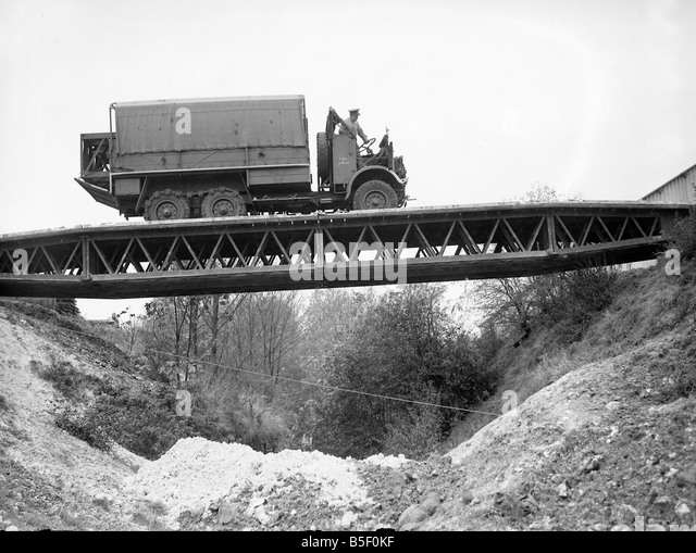 british-army-soldiers-crossing-over-a-bailey-bridge-in-a-truck-during-b5f0kf.jpg