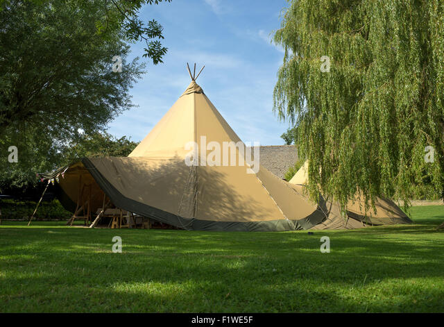 Two large pointy wigwam style tents joined into one. - Stock Image & Conical Tents Tent Stock Photos u0026 Conical Tents Tent Stock Images ...