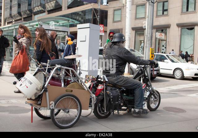 Biker On Mini Bike Toronto,Canada,Yonge And Dundas Corner   Stock Image