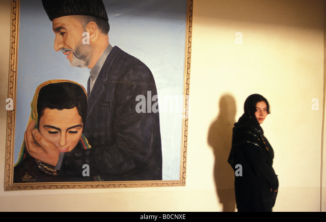 kabul a painting of president hamid karzai showing that he is taking care of womens right