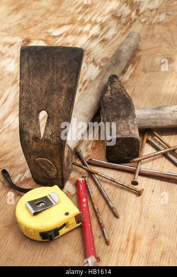 carpenters adze. hammer,adze,measuring tape,nails - stock image carpenters adze