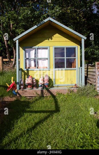 Garden Gnome And House Stock Photos & Garden Gnome And House Stock on