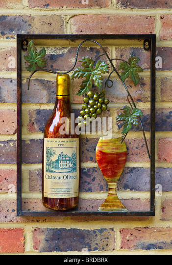 Garden Wall Art In The Shape Of Wine Bottle, Glass And Grapes   Stock Image