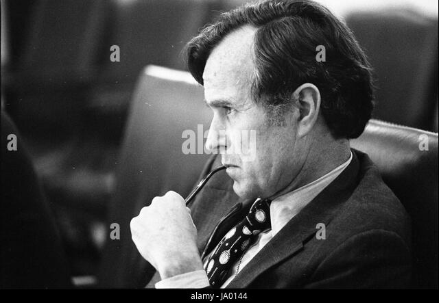 Central intelligence agency director george h w bush listening intently during a meeting to discuss the situation