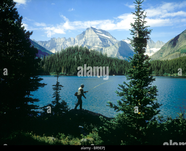Fishing rod and creel stock photos fishing rod and creel for Fishing in glacier national park