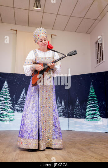 TROY, NEW YORK/USA - FEB 25 2017: Traditional musician, female,  plays balalaika at the annual Russian Festival - Stock Image
