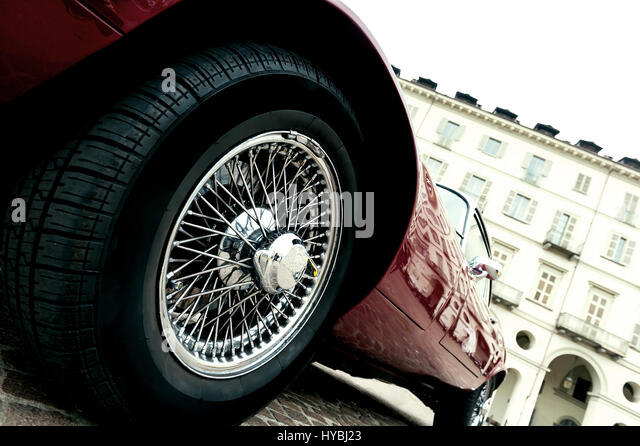 close up of a tire of a red vintage car stock image