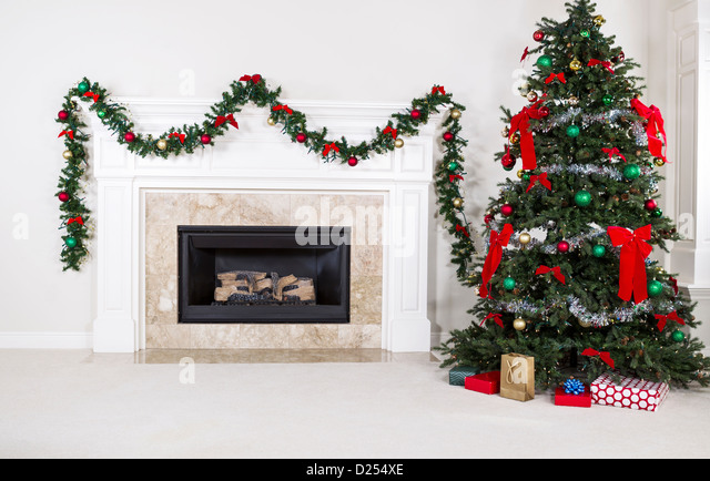 Family and gas fire at home stock photos family and gas for Fully decorated homes
