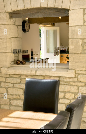 Dining Room Serving Hatch Feature In An Exposed Stone Wall