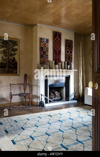 Fireplace With Tribal Ceramic Display And Wall Hangings