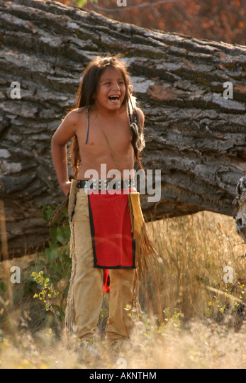 young native american indian boy outside in south dakota