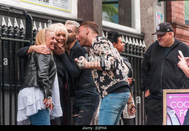 Actress Sherrie Hewson is caught by adoring fans for a photo shoot in Canal Street Manchester - Stock Image