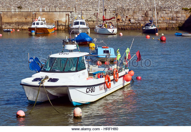 Fishing boat porthcawl harbour south stock photos for Small catamaran fishing boats