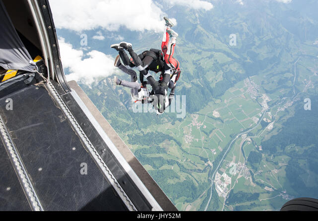 Skydivers exiting a plane in to a head down formation - Stock Image