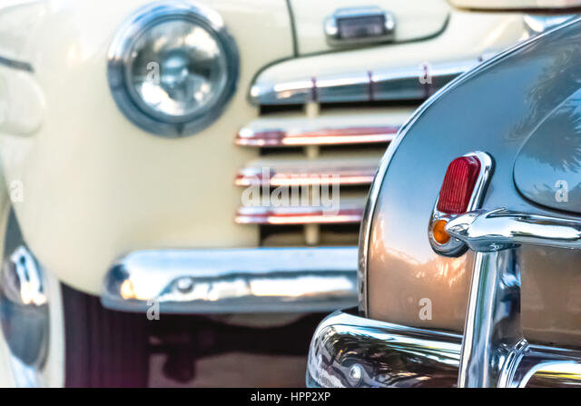 close up view of old cars front and back stock image