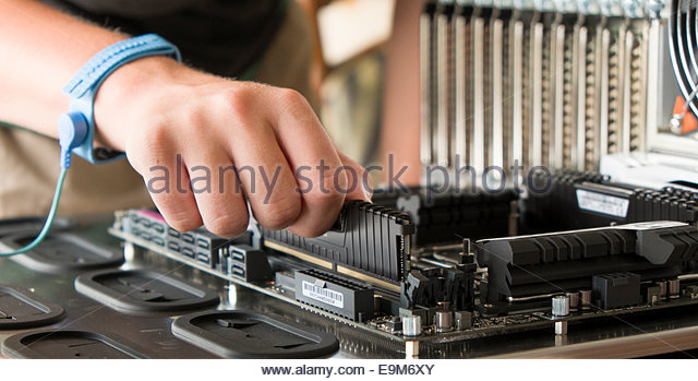 male-teenager-installing-288-pin-ddr4-sd