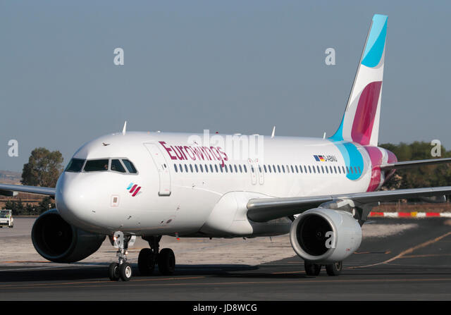 Commercial aviation. Eurowings Airbus A320 airliner taxiing for departure from Malta - Stock Image