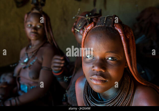 Friendly Himba women in their hut, Kaokoland, Namibia, Africa - Stock Image