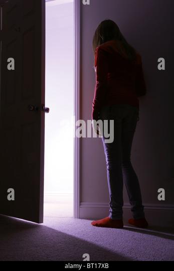 Open Door Dark Room open door with light coming in stock photos & open door with light