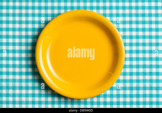 The Empty Plate On Checkered Tablecloth   Stock Image