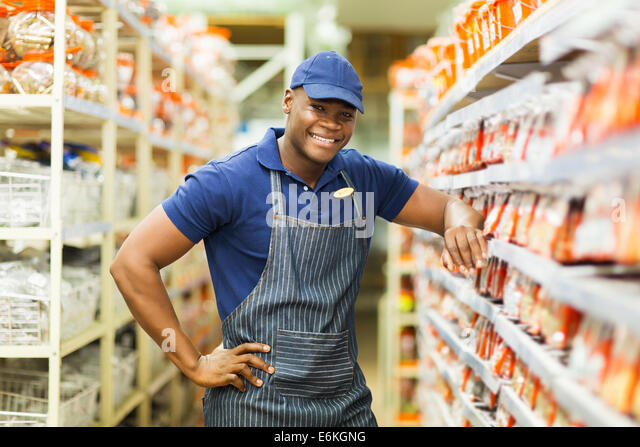 African shop assistant stock photos african shop for Kmart shirts for employees