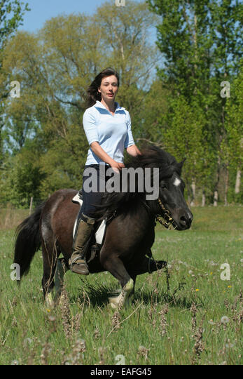 Womens riding mini ponys