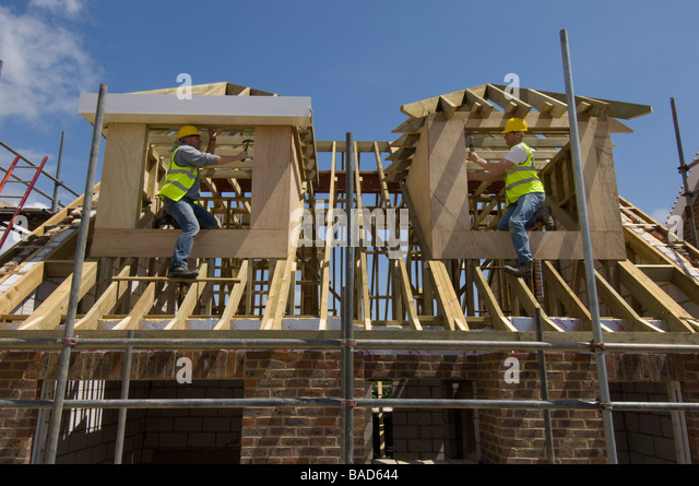 Builders working on dormer windows on the roof of a new house. - Stock Image & Roof Dormer Stock Photos u0026 Roof Dormer Stock Images - Alamy memphite.com