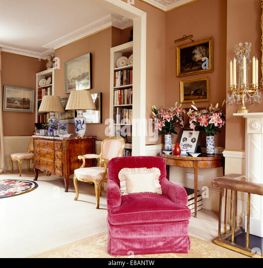 Pink Velvet Upholstered Armchair In Elegant Townhouse Living Room With  Vases Of Pink Lilies On Antique Upholstered Armchair Stock Photos