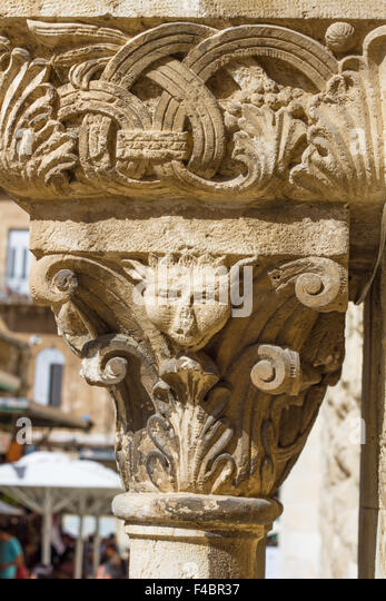 Carved stone grotesque stock photos