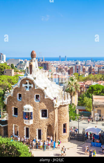 Casa del Guarda lodge by Antoni Gaudi at Parc Guell, UNESCO, with a skyline view of the city of Barcelona, Catalonia, - Stock Image