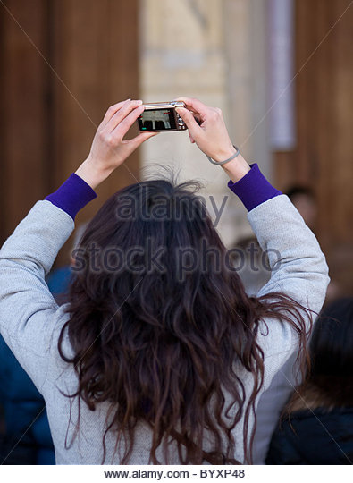 Person taking pictures with s digital camera - Paris France - Stock ...