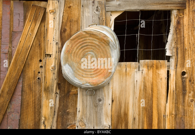 old miners shed with tin wash tub stock image