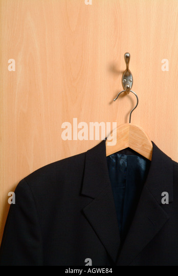 Coathanger And Jacket On The Back Of An Office Door   Stock Image