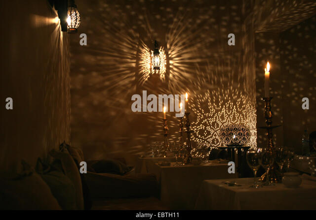 traditonal moroccan lamps casting variations of light and shade in a restaurant morocco marrakesh